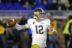 Notre Dame quarterback Ian Book (12) passes during the first half of an NCAA college football game against Duke in Durham, N.C., Saturday, Nov. 9, 2019. (AP Photo/Gerry Broome)