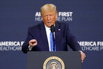 President Donald Trump delivers remarks on healthcare at Charlotte Douglas International Airport, Thursday, Sept. 24, 2020, in Charlotte, N.C. (AP Photo/Chris Carlson)