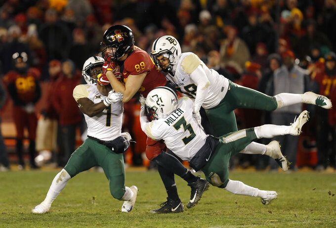 Iowa State tight end Charlie Kolar, center, is brought down by Baylor's Verkedric Vaughns, left, Chris Miller and Jordan Williams, right, during the second half of an NCAA college football game Saturday, Nov. 10, 2018, in Ames, Iowa. Iowa State won 28-14. (AP Photo/Matthew Putney)