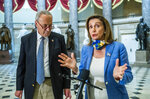 House Speaker Nancy Pelosi of Calif., with Senate Minority Leader Chuck Schumer of N.Y., speaks to reporters following a meeting at the Capitol with White House chief of staff Mark Meadows and Treasury Secretary Steven Mnuchin on a COVID-19 relief bill, Saturday, Aug. 1, 2020, in Washington. (AP Photo/Manuel Balce Ceneta)