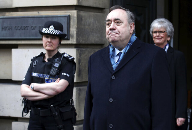 Alex Salmond pauses as he speaks to the media as he leaves the High Court after he was cleared of attempted rape and a series of sexual assaults, including one with intent to rape, against nine women, who were all either working for the Scottish Government or within the SNP at the time, in Edinburgh, Monday, March 23, 2020. (Andrew Milligan/PA via AP)