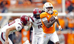 Tennessee wide receiver Marquez Callaway (1) outruns South Carolina punter Joseph Charlton (20) and defensive back R.J. Roderick (10) for a touchdown in the first half of an NCAA college football game Saturday, Oct. 26, 2019, in Knoxville, Tenn. (AP Photo/Wade Payne)