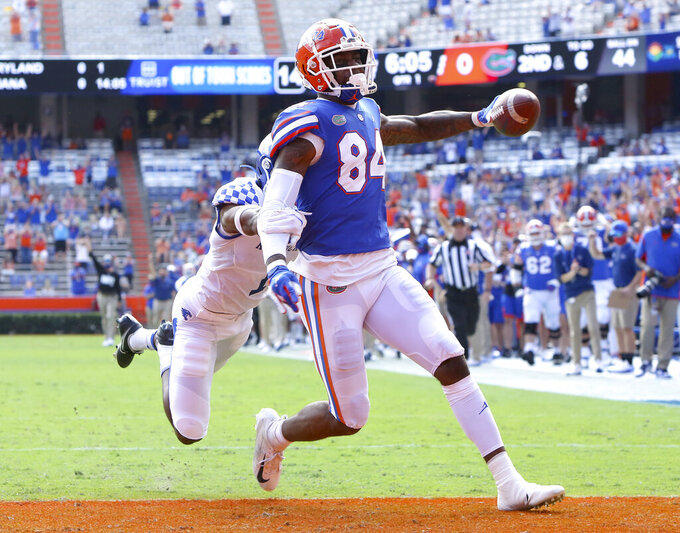 Florida Gators tight end Kyle Pitts (84) scores a touchdown during an NCAA college football game against Kentucky in Gainesville, Fla. Nov. 28, 2020. (Brad McClenny/The Gainesville Sun via AP)