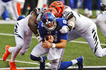 Cincinnati Bengals strong safety Vonn Bell (24) and defensive end Margus Hunt (70) sack New York Giants quarterback Daniel Jones (8) during the first half of NFL football game, Sunday, Nov. 29, 2020, in Cincinnati. (AP Photo/Aaron Doster)