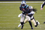 Carolina Panthers wide receiver Pharoh Cooper is tackled by New Orleans Saints cornerback Janoris Jenkins during the first half of an NFL football game Sunday, Jan. 3, 2021, in Charlotte, N.C. (AP Photo/Brian Blanco)
