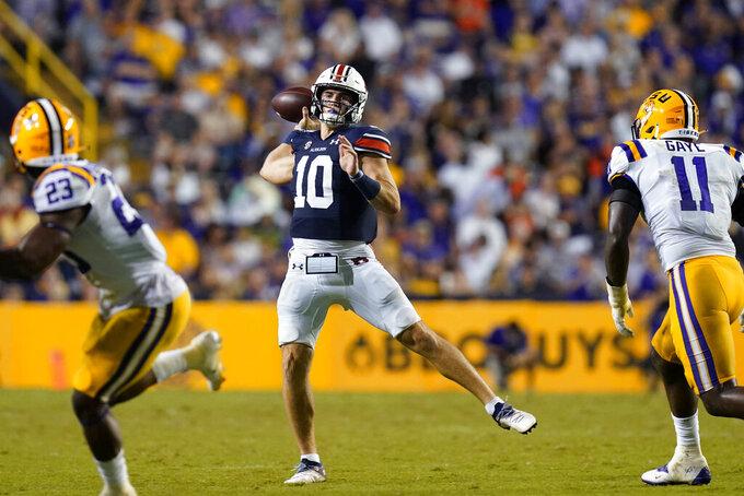 Auburn quarterback Bo Nix (10) passes in the second half of an NCAA college football game against LSU in Baton Rouge, La., Saturday, Oct. 2, 2021. Auburn won 24-19. (AP Photo/Gerald Herbert)