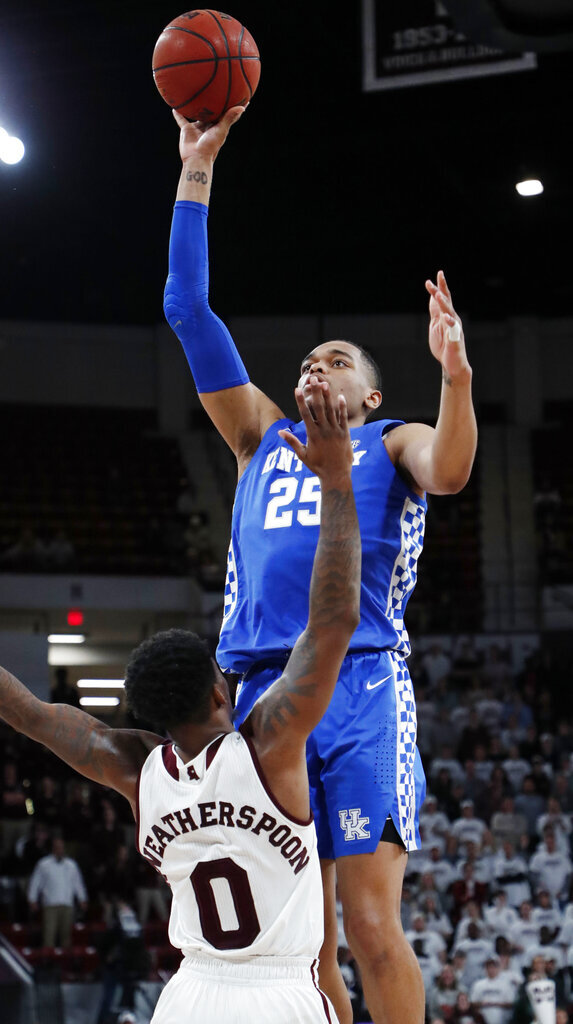 Kentucky forward PJ Washington (25) shoots over Mississippi State guard Nick Weatherspoon (0) during the second half of an NCAA basketball game in Starkville, Miss., Saturday, Feb. 9, 2019. Kentucky won 71-67. (AP Photo/Rogelio V. Solis)
