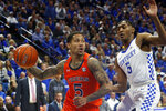 Auburn's J'Von McCormick, left, drives against Kentucky's Immanuel Quickley during the second half of an NCAA college basketball game in Lexington, Ky., Saturday, Feb. 29, 2020. (AP Photo/James Crisp)