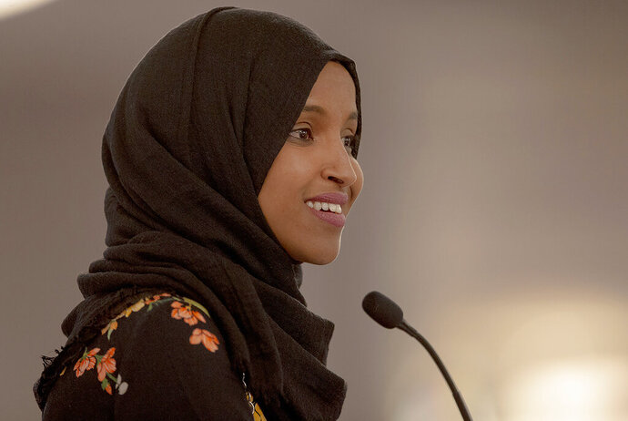 FILE - In this May 18, 2019 file photo, Rep. Ilhan Omar, D-Minn., speaks during the fourth annual Citywide Iftar Dinner in Austin, Texas. A campaign finance investigation found that U.S. Rep. Ilhan Omar filed joint tax returns with her husband before they were legally married. The Minnesota Campaign Finance and Public Disclosure Board says Omar and her husband filed joint tax returns for 2014 and 2015. They weren't married until 2018. Omar's campaign says all of her filings are fully complaint with applicable tax law.(Nick Wagner/Austin American-Statesman via AP, File)