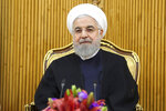 In this photo released by the official website of the office of the Iranian Presidency, President Hassan Rouhani sits at the Mehrabad airport pavilion before leaving Tehran, Iran, for New York to attend United Nations General Assembly, Monday, Sept. 23, 2019. Rouhani, before traveling to attend the U.N. meetings, said Monday that Iran will invite