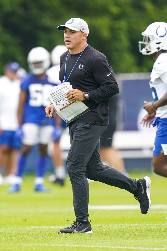 Indianapolis Colts special teams coordinator Bubba Ventrone runs a drill during practice at the NFL team's football training camp in Westfield, Ind., Wednesday, July 28, 2021. (AP Photo/Michael Conroy)