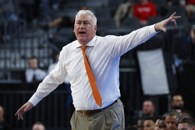 FILE - In this March 11, 2020, file photo, Oregon State head coach Wayne Tinkle motions to his players during the second half of an NCAA college basketball game against Utah in the first round of the Pac-12 men's tournament in Las Vegas. Tinkle is still coach at Oregon State but his son Trey, the school's all-time leading scorer, is awaiting the NBA draft. Shot-blocking specialist Kylor Kelley has moved on too. But Ethan Thompson has returned for his senior season. (AP Photo/John Locher, File)