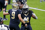 New Orleans Saints running back Alvin Kamara (41) celebrates his touchdown with quarterback Drew Brees (9) in the first half of an NFL football game against the Tampa Bay Buccaneers in New Orleans, Sunday, Sept. 13, 2020. (AP Photo/Brett Duke)