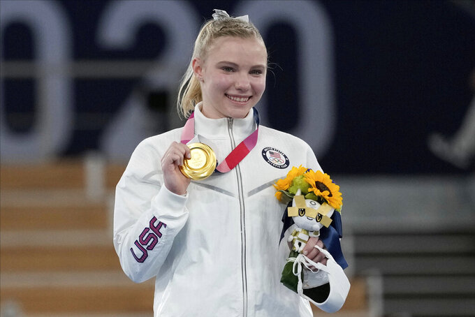 Jade Carey, of the United States, poses after winning the gold medal for the floor exercise during the artistic gymnastics women's apparatus final at the 2020 Summer Olympics, Monday, Aug. 2, 2021, in Tokyo, Japan. (AP Photo/Ashley Landis)