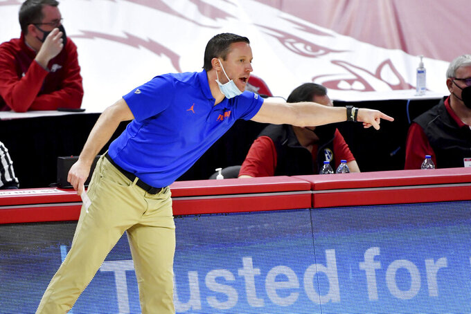 Florida coach Mike White instructs his team as they play Arkansas during the second half of an NCAA college basketball game in Fayetteville, Ark. Tuesday, Feb. 16, 2021. (AP Photo/Michael Woods)