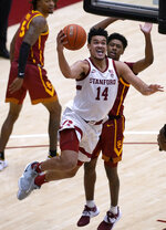 Stanford forward Spencer Jones (14) drives to the basket against Southern California guard Tahj Eaddy (2) during the second half of an NCAA college basketball game in Stanford, Calif., Tuesday, Feb. 2, 2021. Southern California won 72-66.(AP Photo/Tony Avelar)