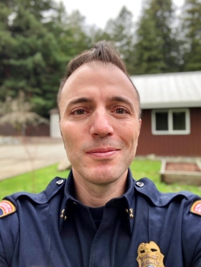 This selfie provided by Justin Silvera shows Silvera, a battalion chief with Cal Fire, after completing a grueling 36 days battling California wildfires to take a 24-hour rest break in Scotts Valley, California, Monday, Sept. 14, 2020. Silvera is one of nearly 15,000 firefighters in California fighting destructive and deadly blazes that have taxed the nation's human, equipment and financial resources barely halfway into the wildfire season. (Justin Silvera/Cal Fire Local 2881 via AP)
