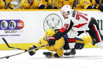 Ottawa Senators right wing Jayce Hawryluk (79) and Nashville Predators defenseman Roman Josi (59), of Switzerland, battle for the puck in the first period of an NHL hockey game Tuesday, Feb. 25, 2020, in Nashville, Tenn. (AP Photo/Mark Humphrey)