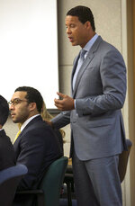 Brian Watkins, right, an attorney for former NFL football player Kellen Winslow Jr., puts his hands on Winslow as he gives his opening statement to the jury during Winslow's rape trial, Monday May 20, 2019, in Vista, Calif. (John Gibbins/The San Diego Union-Tribune via AP, Pool)