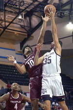 Temple forward Jake Forrester (10) blocks a shot by Texas A&M forward Yavuz Gultekin (35) during the second half of an NCAA college basketball game Friday, Nov. 29, 2019, in Lake Buena Vista, Fla. (AP Photo/Phelan M. Ebenhack)