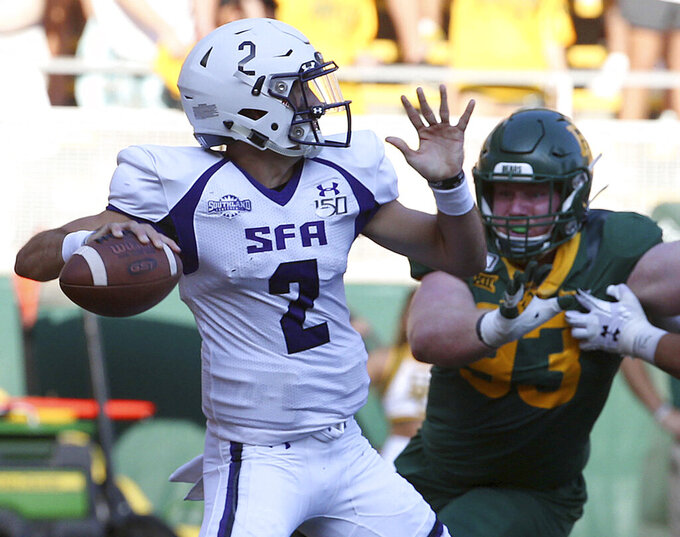 Stephen F. Austin Trae Self (2) passes against Baylor in the first half of an NCAA college football game Saturday, Aug. 31, 2019, in Waco, Texas. (Jerry Larson/Waco Tribune-Herald via AP)