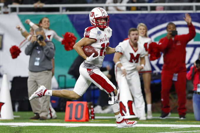 Miami of Ohio wide receiver Jack Sorenson runs for a touchdown during the second half of the Mid-American Conference championship NCAA college football game against Central Michigan, Saturday, Dec. 7, 2019, in Detroit. (AP Photo/Carlos Osorio)