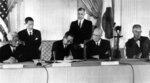 Japan's Prime Minister Nobusuke Kishi signs the U.S.-Japan mutual security treaty, on Jan. 19, 1960, in Washington. From left to right are: Foreign Minister Fujiyama, Kishi, President Dwight D. Eisenhower and Secretary of State Christian Herter. (AP Photo)