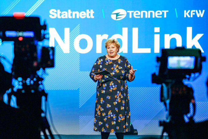 Norway's Prime Minister Erna Solberg speaks during the official opening of the NordLink, the first power connection between Norway and Germany. (Gorm Kallestad / NTB via AP)
