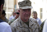 """Marine Gen. Frank McKenzie, the head of U.S. Central Command, attends at a ceremony where Gen. Scott Miller, who has served as America's top commander in Afghanistan since 2018, handed over command, at Resolute Support headquarters, in Kabul, Afghanistan, Monday, July 12, 2021. The United States is a step closer to ending a 20-year military presence that became known as its """"forever war,"""" as Taliban insurgents continue to gain territory across the country. (AP Photo/Ahmad Seir)"""