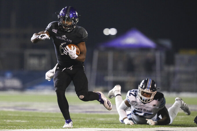 Weber State running back Treshawn Garrett (3) breaks a tackle by Maine's Jamehl Wiley (52) in the first half of a quarterfinal in the NCAA Football Championship Subdivision playoffs Friday, Dec. 7, 2018, in Ogden, Utah. (Matt Herp/Standard-Examiner via AP)
