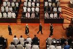 Sri Lankan President Gotabaya Rajapaksa, center right, with speaker Karu Jayasuriya, center left, walk in the well of the house as he arrives to address the ceremonial inauguration of the session in Colombo, Sri Lanka, Friday, Jan. 3, 2020. (AP Photo/Eranga Jayawardena)
