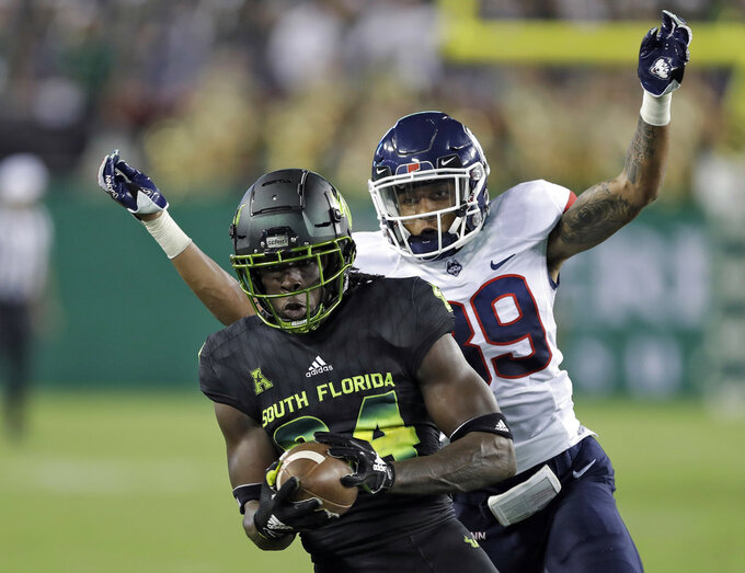 Connecticut defensive back Ryan Carroll (39) catches South Florida wide receiver Randall St. Felix (84) after a reception during the second half of an NCAA college football game Saturday, Oct. 20, 2018, in Tampa, Fla. (AP Photo/Chris O'Meara)