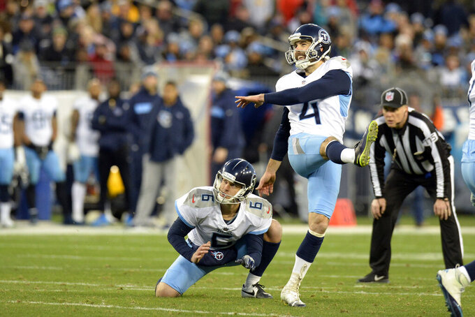 FILE - In this Dec. 22, 2018, file photo, Tennessee Titans kicker Ryan Succop (4) and holder Brett Kern (6) watch a field goal in the first half of an NFL football game against the Washington Redskins, in Nashville, Tenn. The Titans have placed kicker Ryan Succop on injured reserve and have added veteran Cairo Santos to take over for him. Succop hadn't missed a game in five seasons with the Titans but had been recovering from offseason knee surgery. (AP Photo/Mark Zaleski, File)