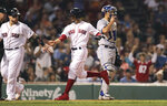 Boston Red Sox's Mookie Betts, center, and Christian Vazquez score on a double by Rafael Devers during the fourth inning of a baseball game against the Toronto Blue Jays at Fenway Park in Boston, Wednesday, July 17, 2019. At right is Toronto Blue Jays catcher Luke Maile. (AP Photo/Charles Krupa)