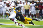 Elon's Bryson Daughtry (8) is tackled by Appalachian State's Trey Cobb (7) during the second quarter of an NCAA college football game, Saturday, Sept. 18, 2021, at Kidd Brewer Stadium in Boone, N.C. (Kenneth Ferriera/News & Record via AP)