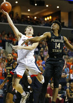 Virginia guard Kyle Guy (5) is fouled as he goes up for a shot against Florida State guard Terance Mann (14) during the first half of an NCAA college basketball game in Charlottesville, Va., Saturday, Jan. 5, 2019. (AP Photo/Steve Helber)