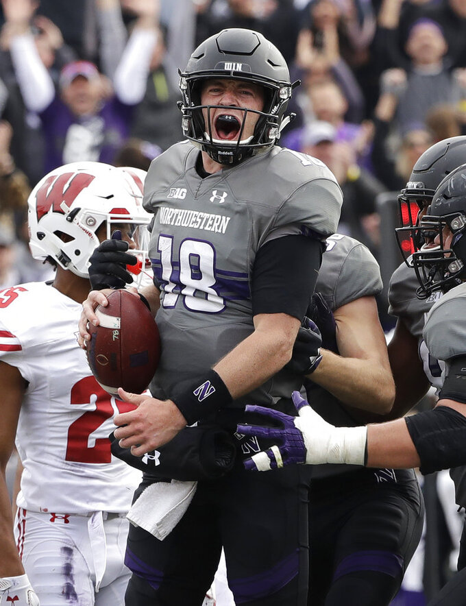 Northwestern quarterback Clayton Thorson (18) reacts as he celebrates after scoring a touchdown against Wisconsin during the first half of an NCAA college football game in Evanston, Ill., Saturday, Oct. 27, 2018. (AP Photo/Nam Y. Huh)