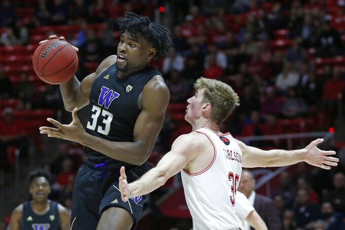 Washington forward Isaiah Stewart (33) passes the ball as Utah center Branden Carlson (35) defends in the first half during an NCAA college basketball game Thursday, Jan. 23, 2020, in Salt Lake City. (AP Photo/Rick Bowmer)