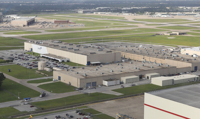 This May 24, 2019 aerial photo, shows the Spirit Aerosystems Facility in Tulsa, Okla. The looming production shutdown of Boeing 737 Max jets is taking a toll on a key supplier. Spirit AeroSystems Holdings Inc. is asking employees if they will take voluntary buyouts. Spirit suspended production of fuselages and other parts for the Max on Jan. 1, after Boeing told the Wichita, Kansas, company to suspend shipments. Employees learned about the buyout offer – with terms depending on union contracts for workers in Wichita, Tulsa and McAlester, Okla. – in a Monday, Jan. 6, 2020, memo from CEO Tom Gentile(Tom Gilbert/Tulsa World via AP)