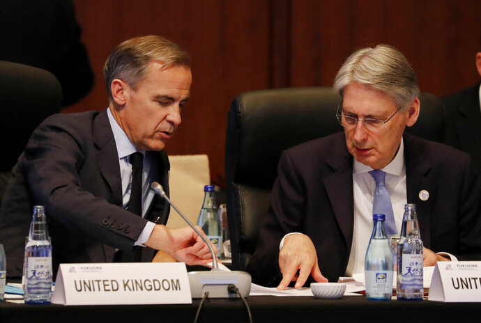 Bank of England Governor, Mark Carney talks with British Chancellor of the Exchequer Philip Hammond during the G20 Finance Ministers and Central Bank Governors Meeting, Saturday, June 8, 2019, in Fukuoka, Japan. (Kim Kyung-hoon/Pool Photo via AP)