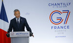 French Finance Minister Bruno Le Maire delivers his speech at the end of the G-7 Finance Thursday, July 18, 2019 in Chantilly, north of Paris. Finance ministers from the Group of Seven rich democracies are sounding the alarm on the dangers of cryptocurrencies and pouring cold water on Facebook's Libra as they wrap up a two-day meeting in Chantilly, France. (AP Photo/Michel Euler)