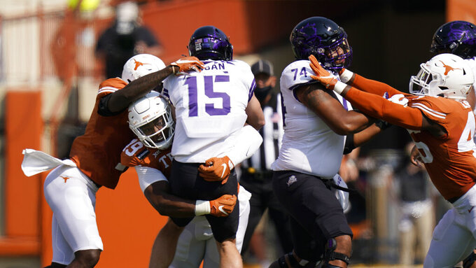 TCU quarterback Max Duggan (15) is hit by Texas linebacker Joseph Ossai (46) during the first half of an NCAA college football game, Saturday, Oct. 3, 2020, in Austin, Texas. (AP Photo/Eric Gay)