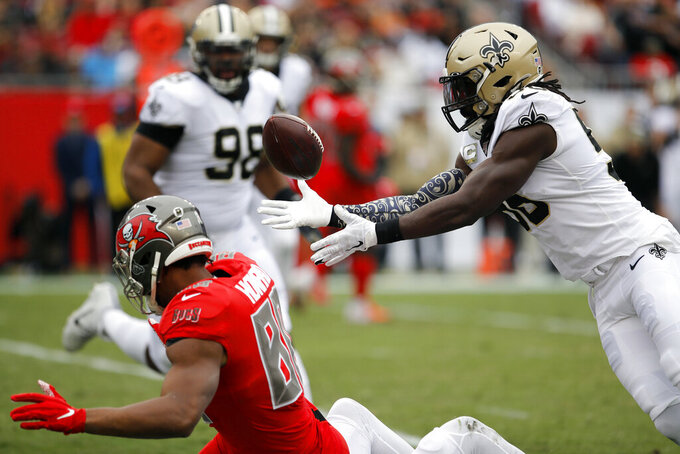 New Orleans Saints outside linebacker Demario Davis (56) intercepts a pass intended for Tampa Bay Buccaneers tight end O.J. Howard (80) during the first half of an NFL football game Sunday, Nov. 17, 2019, in Tampa, Fla. (AP Photo/Mark LoMoglio)