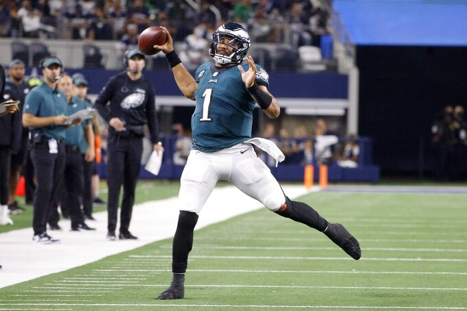 Philadelphia Eagles quarterback Jalen Hurts (1) throws a pass late in the second half of an NFL football game against the Dallas Cowboys in Arlington, Texas, Monday, Sept. 27, 2021. (AP Photo/Michael Ainsworth)