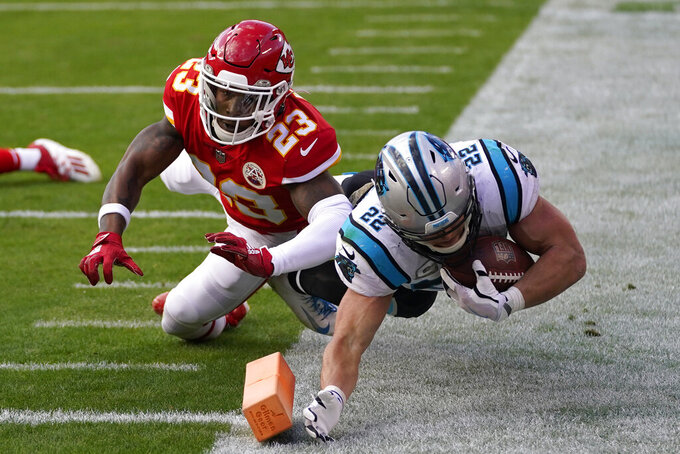 Carolina Panthers running back Christian McCaffrey (22) is knocked out of bounds by Kansas City Chiefs safety Armani Watts (23) during the second half of an NFL football game in Kansas City, Mo., Sunday, Nov. 8, 2020. (AP Photo/Jeff Roberson)