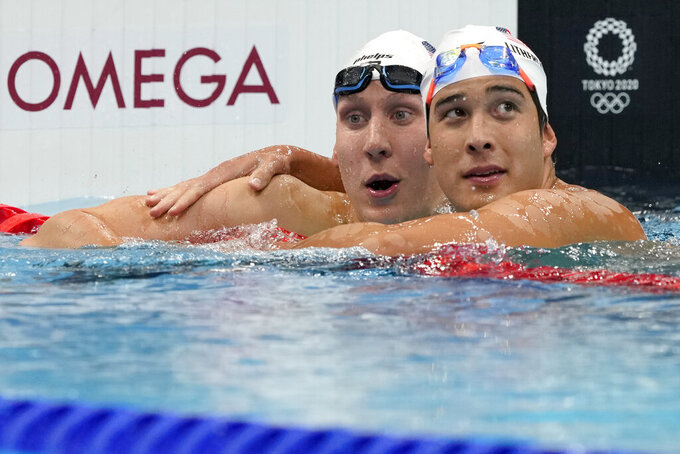 Chase Kalisz, left, of the United States, celebrates with teammate Jay Litherland after winning the final of the men's 400-meter individual medley at the 2020 Summer Olympics, Sunday, July 25, 2021, in Tokyo, Japan.