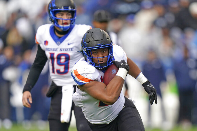 Boise State running back Andrew Van Buren (21) carries the the ball against BYU in the first half during an NCAA college football game Saturday, Oct. 9, 2021, in Provo, Utah. (AP Photo/Rick Bowmer)