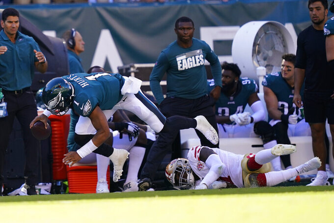 Philadelphia Eagles quarterback Jalen Hurts (1) falls with the ball during the second half of an NFL football game against the San Francisco 49ers on Sunday, Sept. 19, 2021, in Philadelphia. (AP Photo/Matt Rourke)