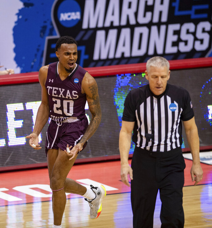 Texas Southern guard Michael Weathers (20) reacts to a referee after being called for a foul during the second half of the team's First Four game against Mount St. Mary's in the NCAA men's college basketball tournament Thursday, March 18, 2021, in Bloomington, Ind. (AP Photo/Doug McSchooler)