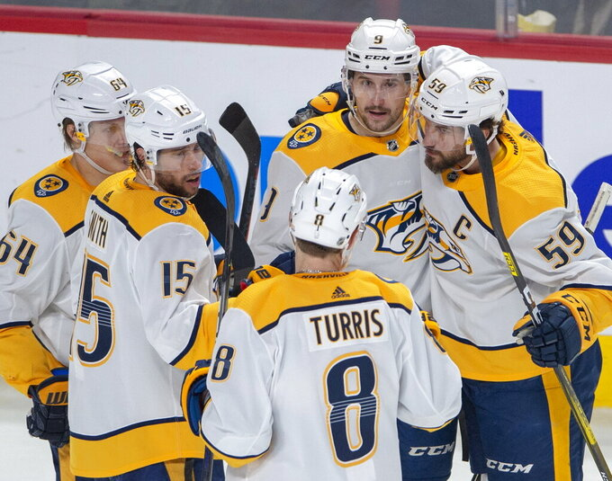 Nashville Predators left wing Filip Forsberg (9) celebrates with teammates after against the Montreal Canadiens during the second period of an NHL hockey game Tuesday, March 10, 2020, in Montreal. (Ryan Remiorz/The Canadian Press via AP)